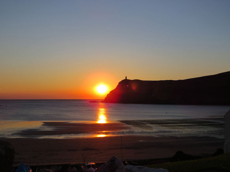 Imgae of sunset over the sea and beside Bradda Head at Port Erin