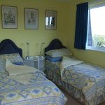 Image of guest room set out with twin beds